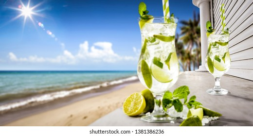 Summer bar background with beach landscape and cold fresh drink. Summer time