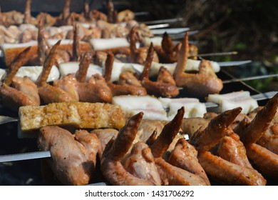 Summer barbecue with hot chicken wings and pig fat, pork belly or salo close up.  Spring BBQ outdoors.