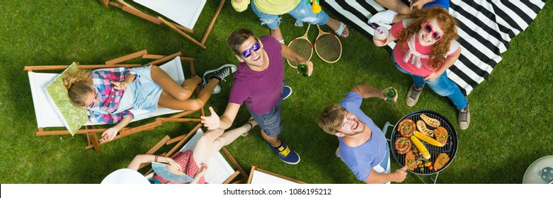 Summer barbeque party with friends in a garden