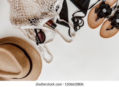Summer beach accessories on pastel background. Hipster items flat lay