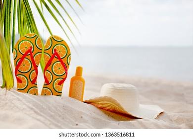 Summer beach background with flip flops