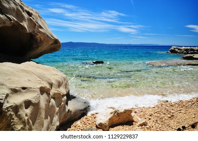 Summer beach by sunny blue sea