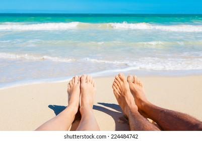 Summer and beach concept - couple lying on the beach