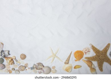 Summer and Beach Concept. Sandy Beach with Starfish And Various Sea Shell