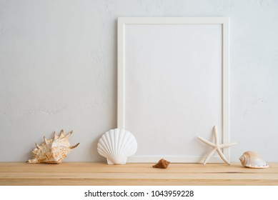 Summer beach holiday vacation concept, photo frame and seashell decoration mockup with white wall background