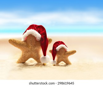 Summer beach. Merry Christmas. Starfish in Santa Claus hat.
