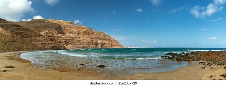 Summer beach panorama, Orzola playa la Cantera in Lanzarote, the Canary Islands