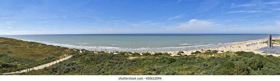 Summer beach panorama scene at De Panne in Belgium