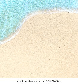 Summer beach and soft wave background. Sand and sea. Tropical summer vacation concept with copyspace