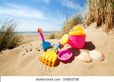 Summer beach toys in the sand concept for holiday and vacations