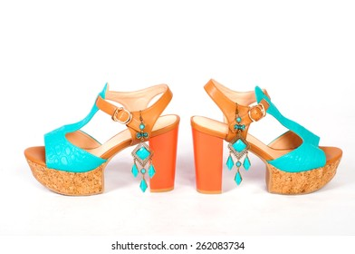 Summer beautiful high heels and beautiful earrings on a white background