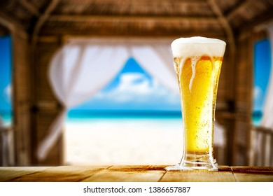 Summer beer on table and beach landscape