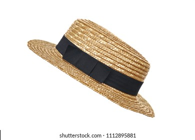 Summer beige straw hat isolated on white background.Close up of handcraft weave wide brim hat made from reed,bamboo,rattan.Decoration with ribbon band on plain design.Fashion,Holiday,Decor Concept.