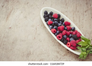 Summer berries on a plate/toned photo