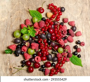 Summer berries on wooden background
