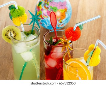 Summer beverages, cocktail with ice, juice and fruit.