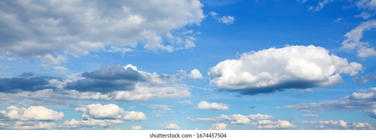 Summer blue sky background wiht white clouds .