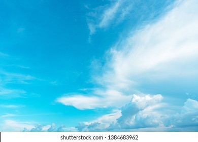 Summer blue sky soft clear Cloudy background. Puffy Cloud move by windy on beach concept Felling good-tempered relaxing  sunset wallpaper, sunrise journey to travel in tropical fog shiny mist style