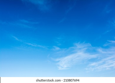 Summer Blue Sky With Soft White Clouds
