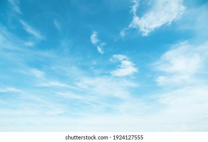 Summer Blue Sky and white cloud white background. Beautiful clear cloudy in sunlight calm season. Panoramic vivid cyan landscape in nature environment. Outdoor horizon skyline with spring sunshine. - Shutterstock ID 1924127555