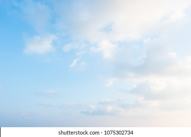 Summer blue sky and white soft and fluffy clouds in sunny day for background.