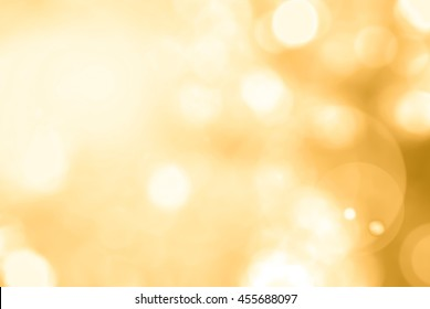 Summer blurred nature background view looking up through tree leaves against sky facing sun flare and bokeh