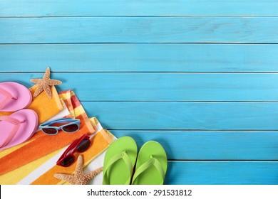 Summer border, beach background, sunglasses, blue wood deck, copy space