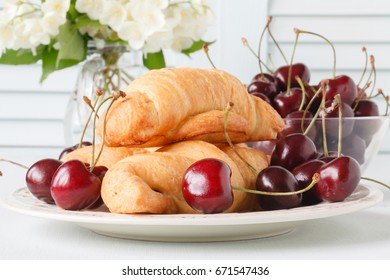 Summer breakfast outdoor with pastries and berries