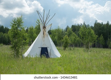 Summer camping tent, Indian wigwam hut, Tipi - Native American tent in the summer lanscape