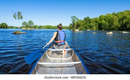 Summer canoeing on Swedish lake