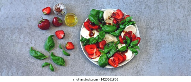 Summer caprese salad. Caprese with strawberries. Dietary salad with basil and mozzarella. Keto diet.