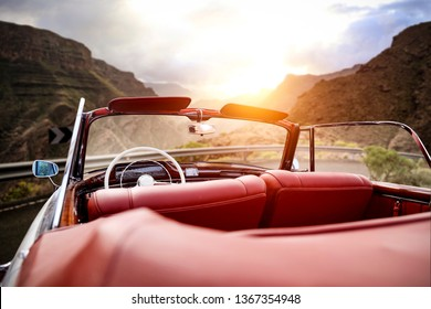 Summer car on road and sunset time in mountains.