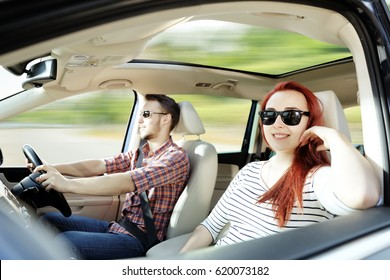 Summer car trip and two lovers in car
