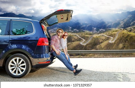 Summer car trip and two young people. Free space for your decoration.