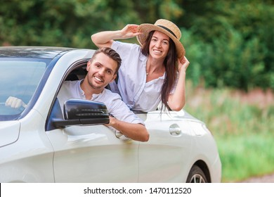 Summer car trip and two young people. Young couple tourist enjoying vacation.