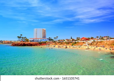 Summer card, turquoise sea and beach in Spain, La Zenia, Orihuela Costa