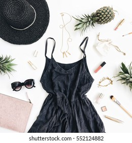 Summer casual style. Modern woman clothes and accessories collage. Dress, sunglasses, hat, purse, lipstick and pineapples. Flat lay, top view