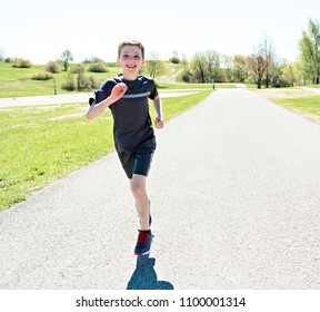 summer, childhood, leisure and people concept happy little boy running