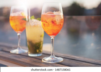 summer citrus cold alcohol drink Aperol Spritz close-up, sunny party time