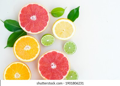summer citruses background, exotic border on neutral background