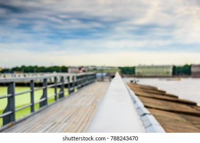 Summer in the city, a walking terrace with panoramic views of the city. Close up view from the handrail on the sidewalk level
