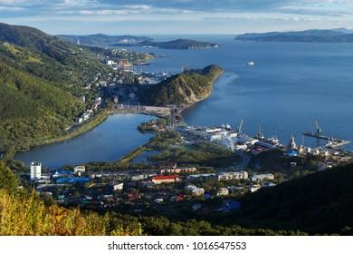 Summer cityscape of Kamchatka Peninsula: top view of center of Petropavlovsk-Kamchatsky City, beautiful mountains along shores of Avacha Bay (Avachinskaya Bay) and Pacific Ocean. Russian Far East.