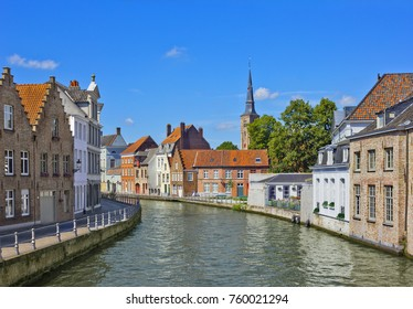 Summer cityscape with old buildings on the canal bank in Bruges, Belgium