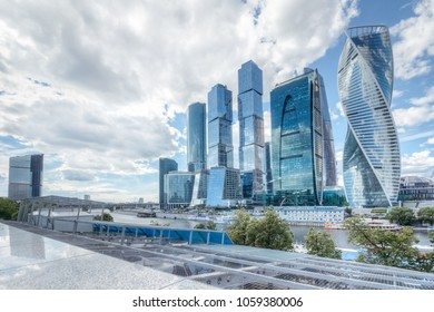 Summer cityscape with a view of Moscow's skyscrapers Moscow business center with modern buildings under a summer blue sky with cumulus white clouds