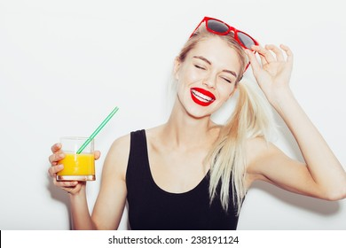 Summer closeup portrait of pretty smiling blonde woman in sunglasses with cocktail