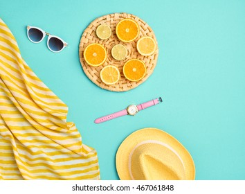 Summer Clothes Accessories Set. Flat lay. Fashion woman Trendy Hipster Sunglasses. Stylish girl Outfit.Tropical Fresh Fruit. Creative fashionable summertime Pastel Art Concept