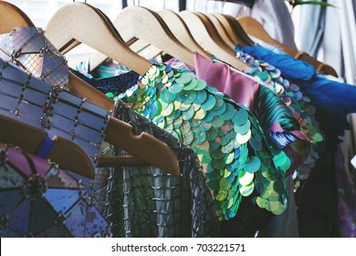 summer clothes on hangers with swquins