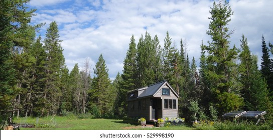 Summer clouds over a off grid tiny house.