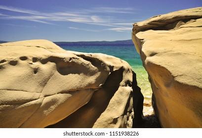 Summer coast view of sea behind rocks