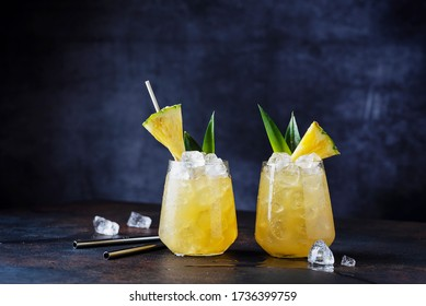 Summer cocktail and bar concept. Fresh alcoholic cocktail with pineapple and ice. Selective focus image with copy space